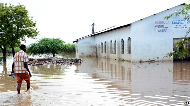 A church elder makes his way to his church through flood waters at Bangula, Malawi, in the southern district of Nsanje, Sunday Jan. 18, 2015.