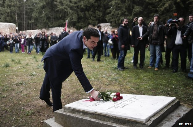 Alexis Tsipras lays flowers at a war memorial in Athens, 26 January