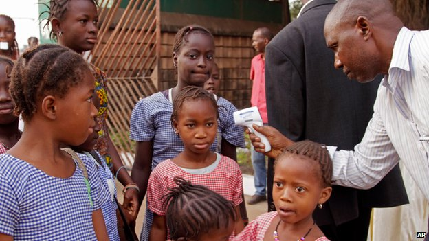 School children having their temperature tested in Guinea on 19 January 2015
