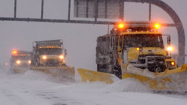 Massachusetts Department of Transportation plow crews clear the snow