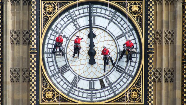 Abseilers clean and inspect the famous Westminster clock face