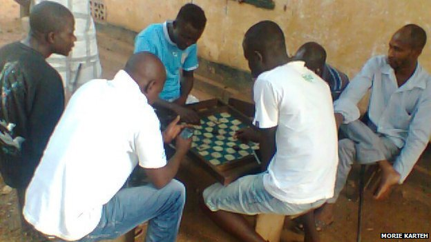 Group of teachers in Sierra Leone playing a board game