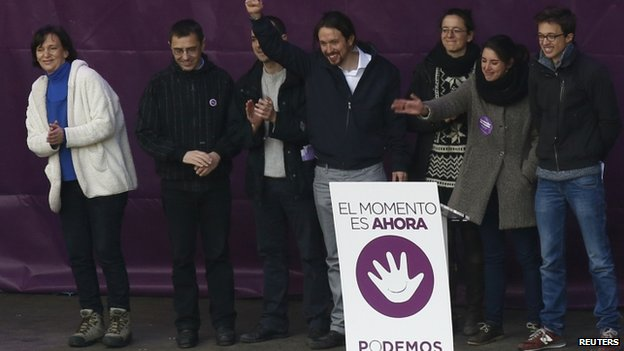 Pablo Iglesias with other Podemos leaders on stage at rally - 31 January