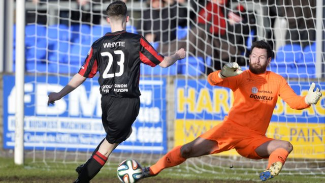 Match action from Dungannon Swifts against Crusaders at Stangmore Park