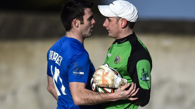 Glenavon's Eoin Bradley with Warrenpoint goalkeeper Jonathan Parr