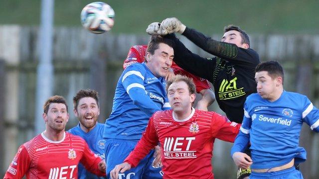 Match action from Ballinamallard against Portadown