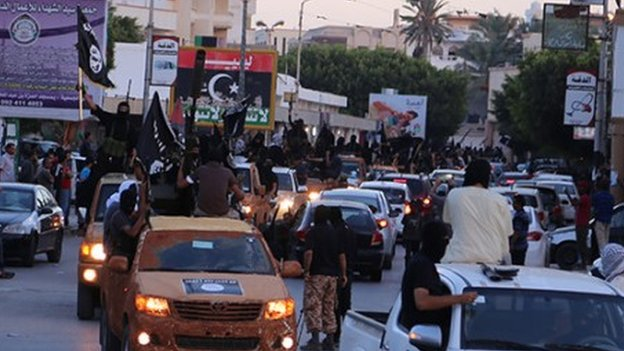 Islamic State militants parading through Derna