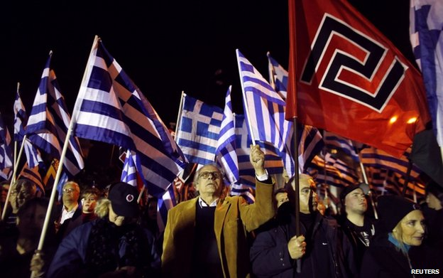 Supporters of the far-right Golden Dawn party wave Greek national and party flags during a rally in Athens January 31, 2015.
