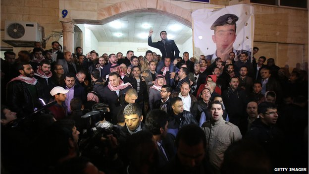 People gather in Amman, Jordan, after the video was released