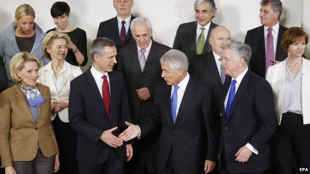 NATO Secretary General Jens Stoltenberg (front 2-L) shakes hand with US Secretary of Defense Chuck Hagel (front C) at a Nato meeting