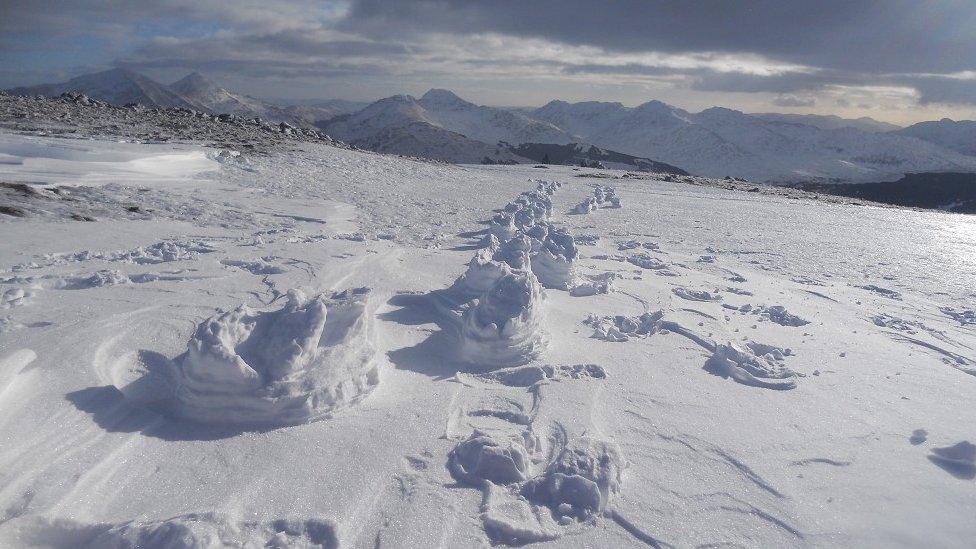 Raised footprints in snow