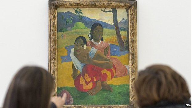 """Two women look at the painting """"Nafea faa ipoipo"""" (When will you marry?, 1892) by French painter Paul Gauguin on display in the Fondation Beyeler in Riehen, Switzerland, 06 February 2015"""