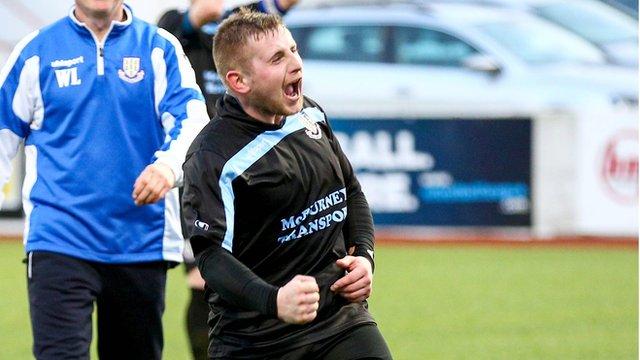 David Cushley celebrates scoring the winner against Cliftonville