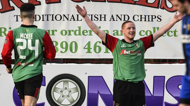 Glentoran's Stephen McAlorum celebrates scoring against Armagh City