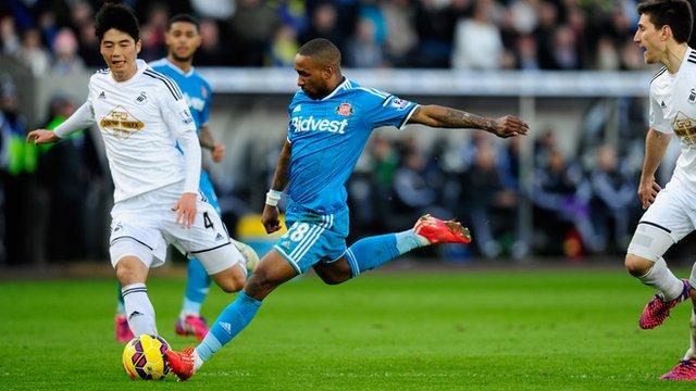 Sunderland striker Jermain Defoe shoots to score against Swansea