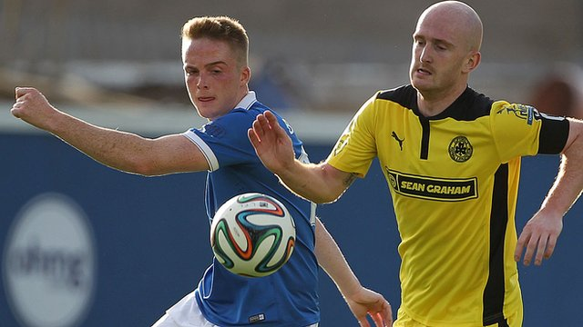 Linfield's Aaron Burns in action against Ryan Catney of Cliftonville