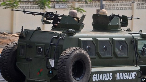 Nigerian soldiers patrol with a armoured vehicle in the city of Abuja, Nigeria, Saturday, 7 Feb, 2015