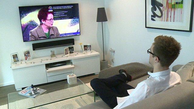 Peter Kent watching TV