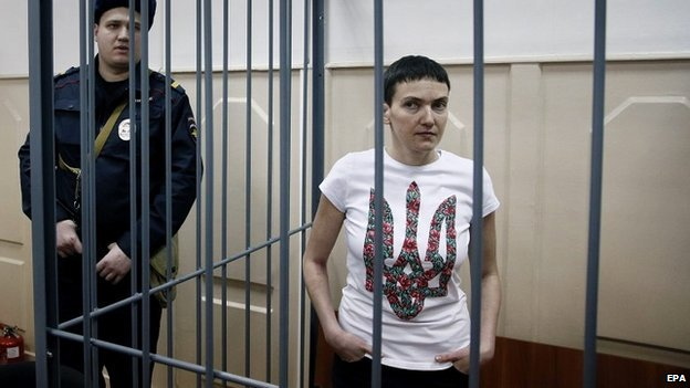 Ukrainian pilot Nadiya Savchenko stands in a cage in a court room in Moscow, Russia - 10 February 2015