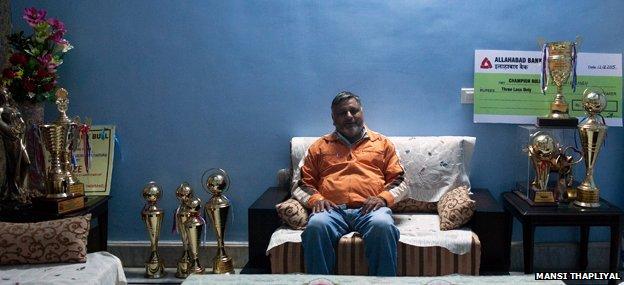 Singh with Yuvraj's trophies