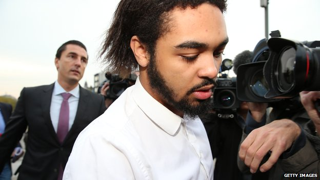 Jejoen Bontinck followed by his lawyer Kris Luyckx, arrives for the first day of the trial of radical Islamic group 'Sharia4Belgium' at the courthouse of Antwerp on 29 September 2014.