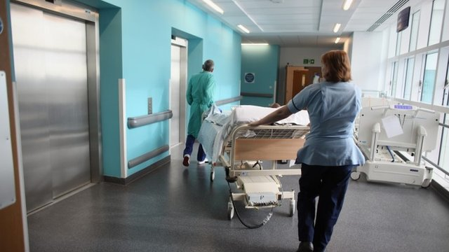 Medical staff moving a patient