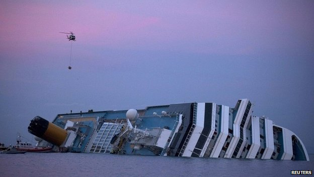 A helicopter approaches the Costa Concordia cruise ship off the west coast of Italy - 19 January 2012