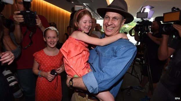 Peter Greste is reunited with his family at Brisbane airport on 5 February 2015