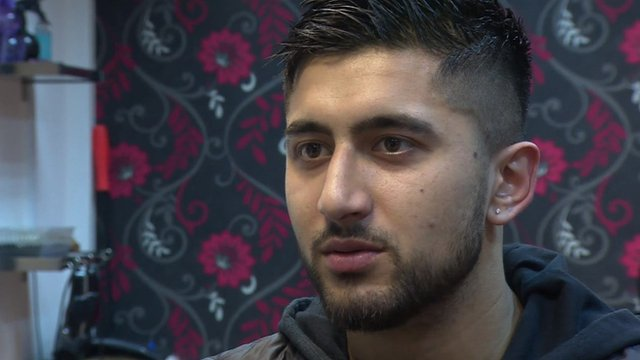 Barber, Idris Yousaf, talking to the BBC in his Wallsall barber shop
