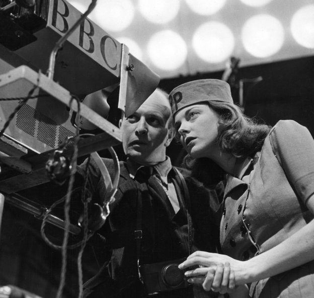 Patricia (Paddy) Bath, hostess of the weekly television magazine programme Picture Page, with a lighting engineer, at Alexandra Palace.