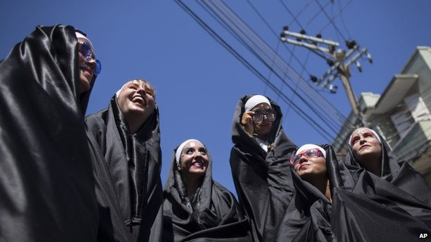 "Revelers dressed as nuns perform during the ""Carmelitas"" carnival parade in Rio de Janeiro, Brazil"