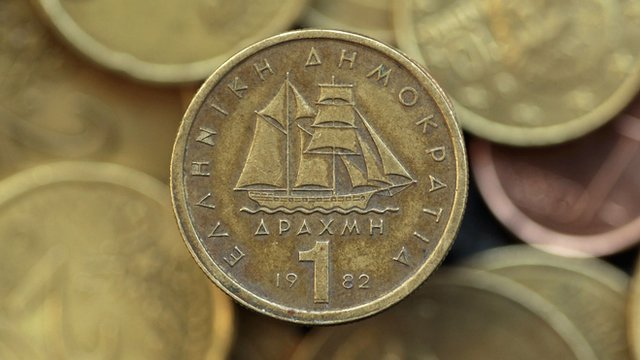A drachma coin is seen on display in this photo illustration taken in Athens in this May 9, 2012 file photo