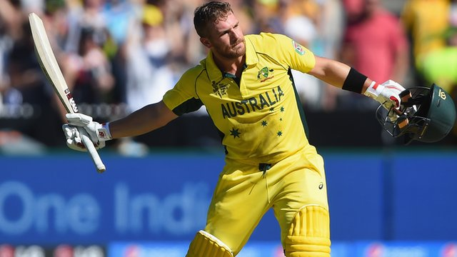 Aaron Finch celebrates after scoring a century of runs