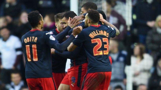 Reading players surround goalscorer Hal Robson-Kanu