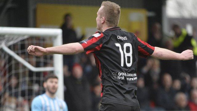 Crusaders Jordan Owens celebrates scoring against Warrenpoint Town