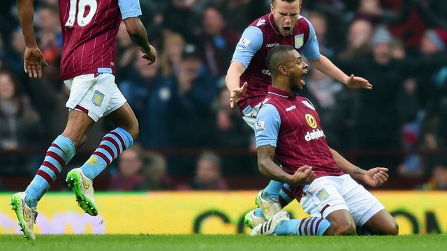 Aston Villa's Leandro Bacuna celebrates opening the scoring against Leicester City.