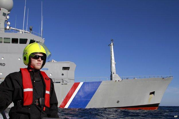 seaman Aron Asgeirsson circles the Icelandic Coast Guard ship Tyr during a routine exercise