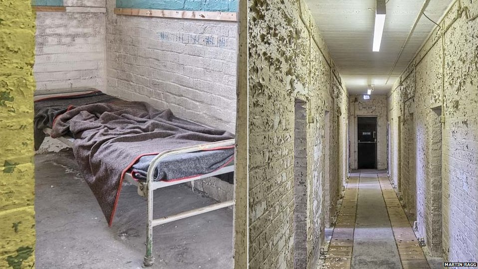 A bed and corridor at Cultybraggan