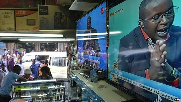 A televised debate on charges faced by Kenyan President Uhuru Kenyatta at the Hague-based International Criminal Court (ICC) being dropped, is aired on television sets displayed in an electronics shop, on 5 December 2014, in the Kenyan capital Nairobi