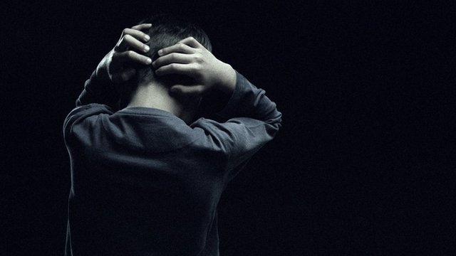 Model-released image of boy with hands behind head