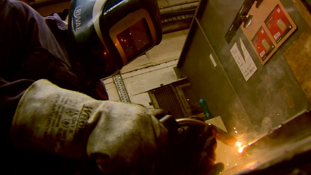 Worker using blow-torch