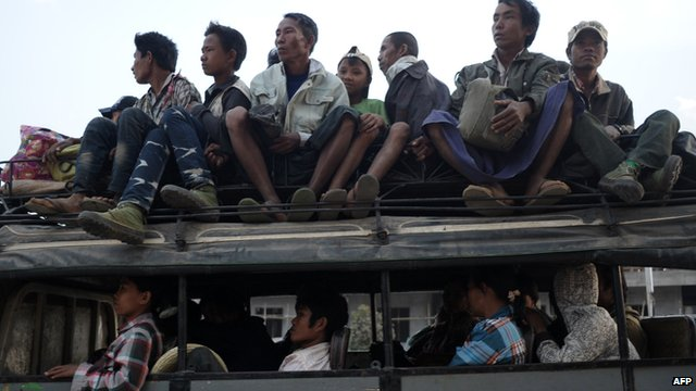 Residents who fled from conflict areas near the Myanmar and Chinese border arrive at a temporary refugee camp at a monastery in Lashio, northern Myanmar on 19 February 2015