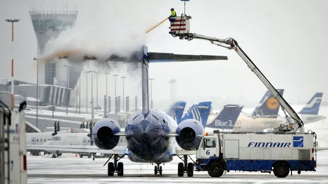 Plane being de-iced at Helsinki airport