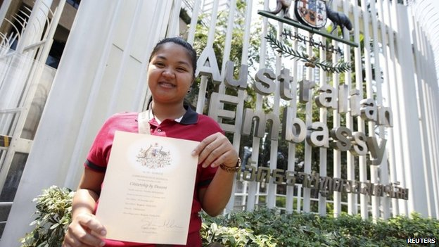 Thai surrogate mother Pattaramon Chanbua shows a certificate of Australian citizenship for the baby she gave birth to, to the media at the Australian Embassy, in Bangkok February 9, 2015