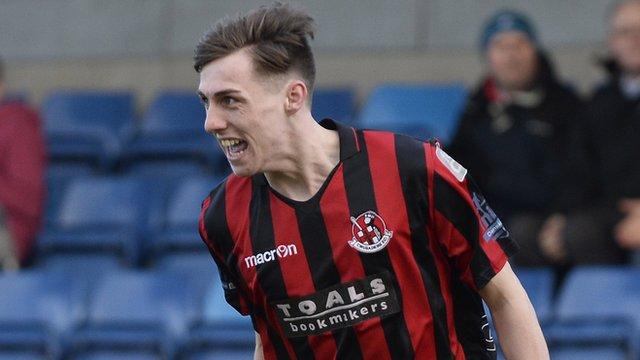 Crusaders Gavin Whyte celebrates scoring a hat-trick against Glenavon