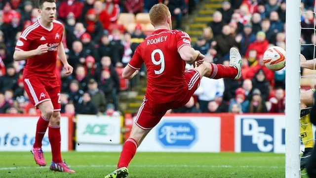 Adam Rooney prods home to give Aberdeen the lead against St Mirren