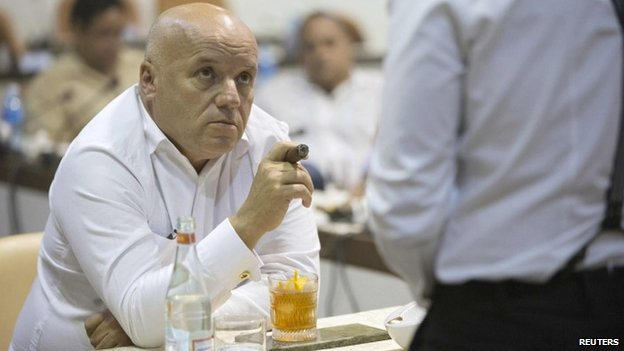 A member of the jury, (L), listens to a sommelier during a cigar sommelier contest at the XVII Habanos Festival in Havana, February 23, 2015
