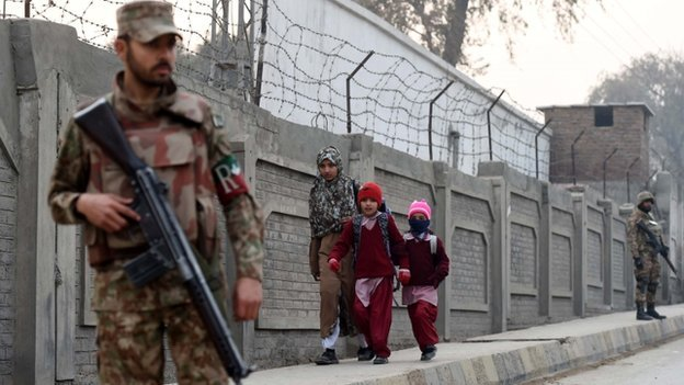 Pupils going back to school in Peshawar