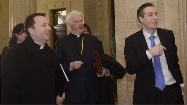 Fr Tim Bartlett, Bishop Noel Treanor and Paul Givan