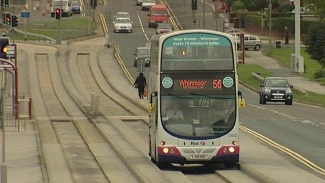 Bus running between guide rails